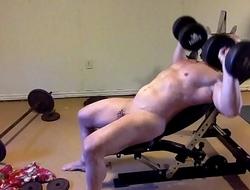 slave Doing Incline Bench Press
