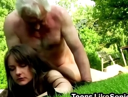 Teen with big tits riding old guy cock outdoors