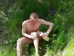 Gang totally naked and masturbates in nature