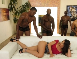 Young latina with pierced nipples enjoys interracial gangbang